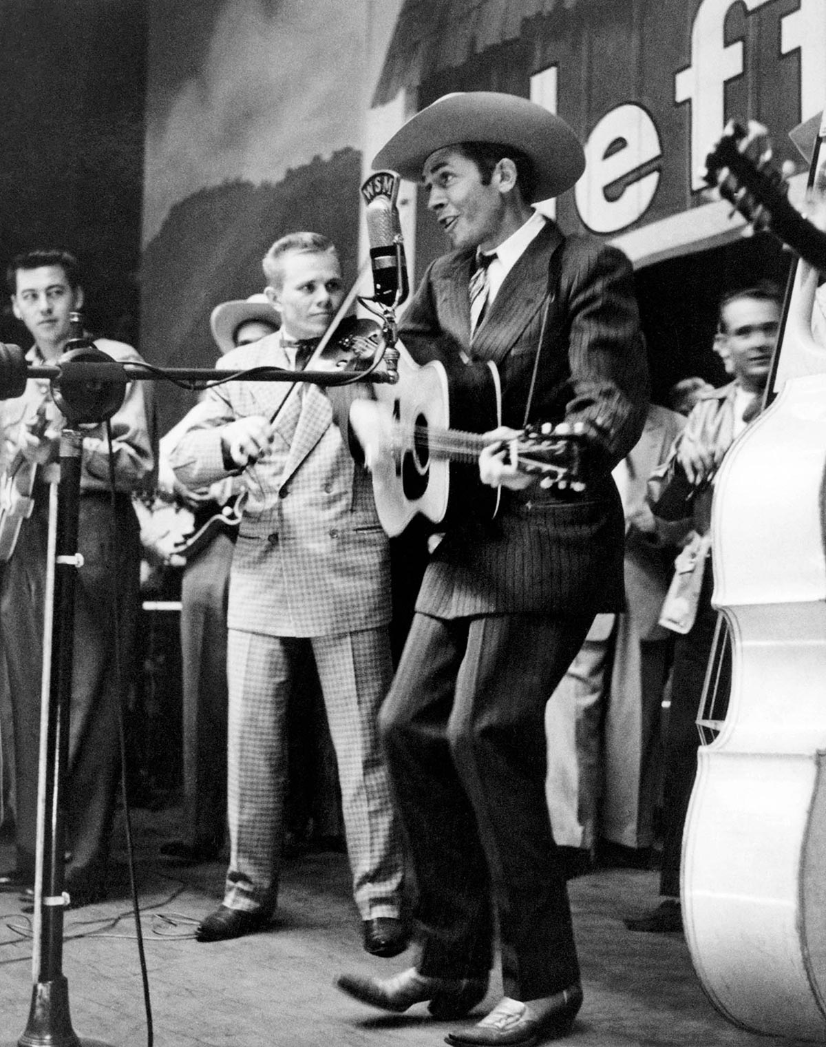 Hank Williams performing on the Grand Ole Opry wearing the suit that is now on display